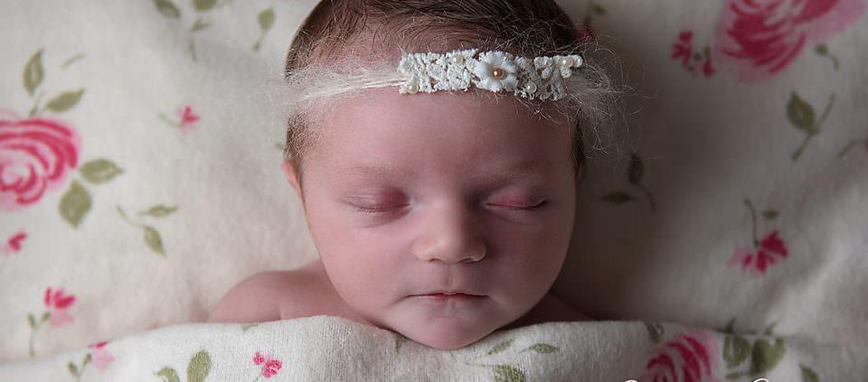 Sleeping newborn baby by Sandra Cullen Photography