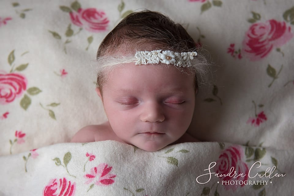 Sleeping newborn baby by Sandra Cullen Photography