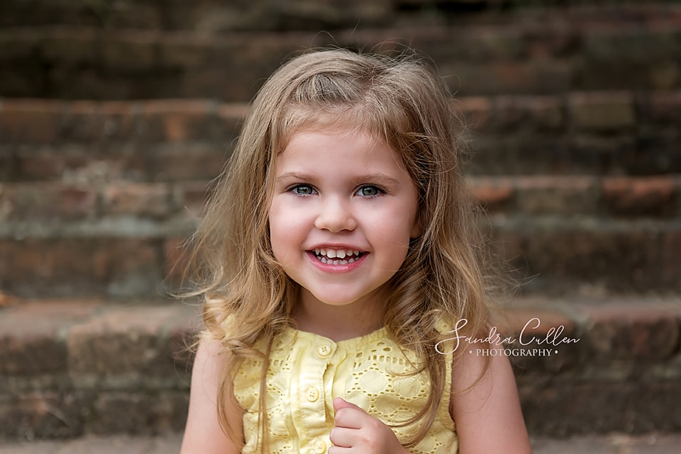 Smiling toddler by Sandra Cullen Photography